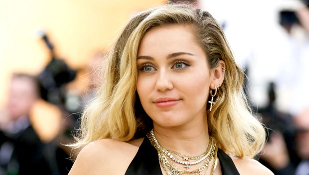 Miley Cyrus Poses Topless To Promote Her New Song See New Pic Of Her Half Naked In Bed Top News Wood